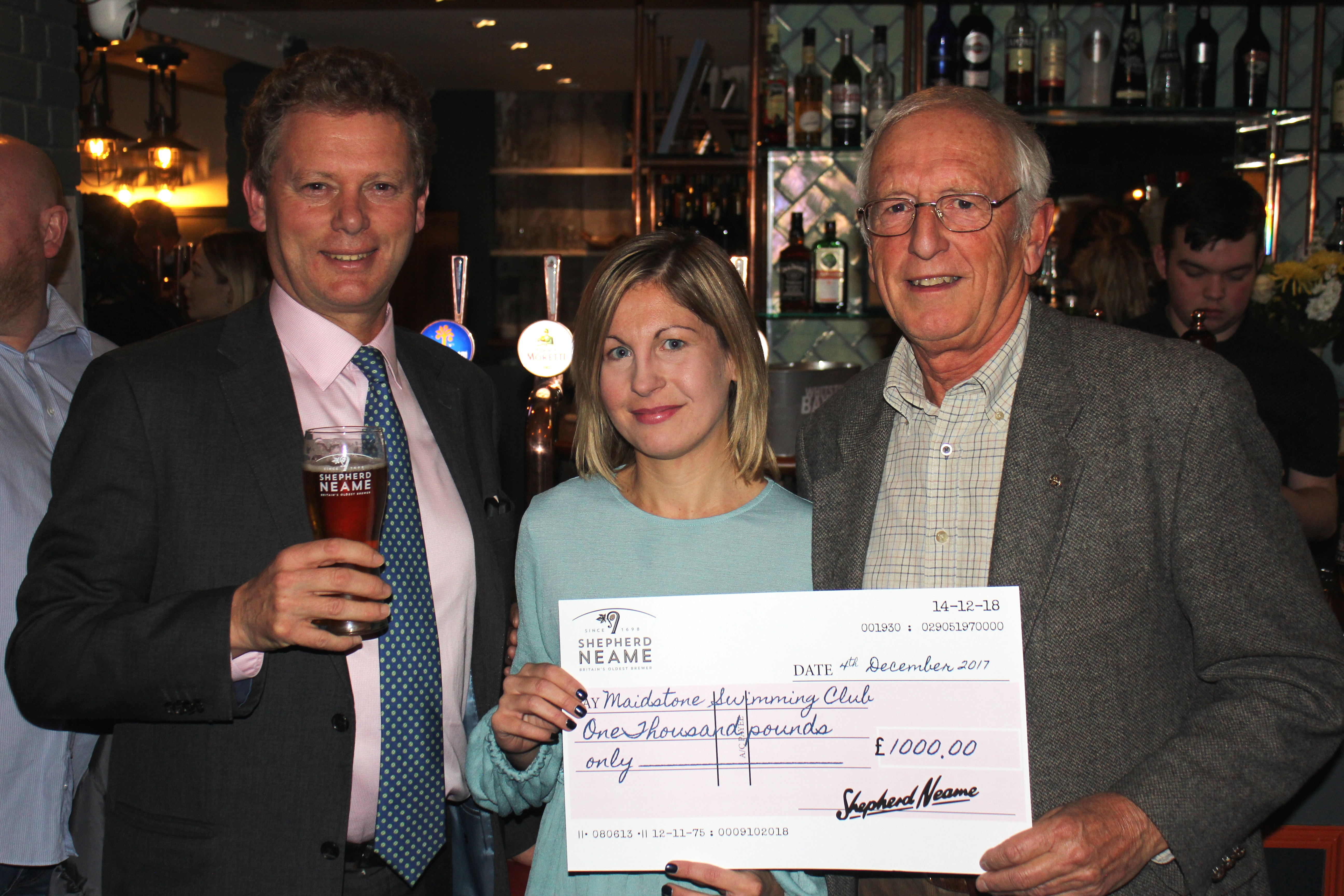 Shepherd Neame CEO Jonathan Neame with Clive Bradburn of Maidstone Swimming Club for the Disabled and club supporter Gemma Hall