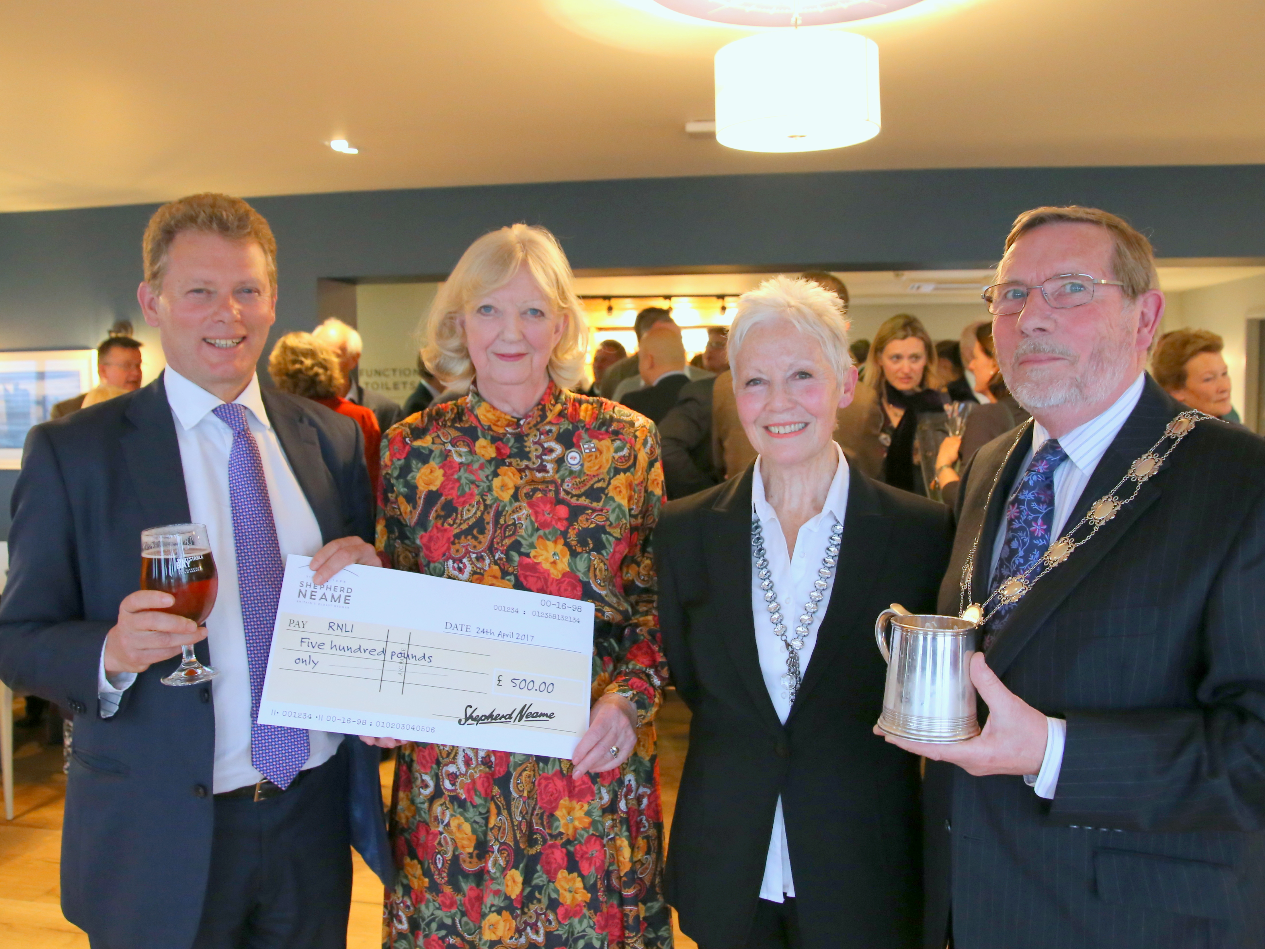 Jonathan Neame presents a cheque for the RNLI at the reopening of the Minnis Bay, with Fiz Gulliver-Crane of Birchington RNLI, Barbara Sturgeon and Cllr Neville Hudson