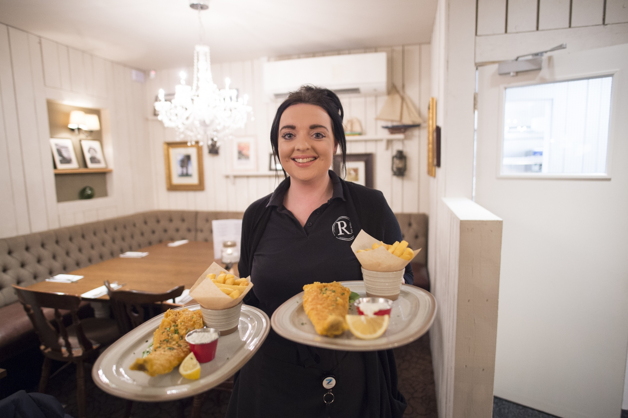 Waitress serves food at the new-look Royal, Tankerton